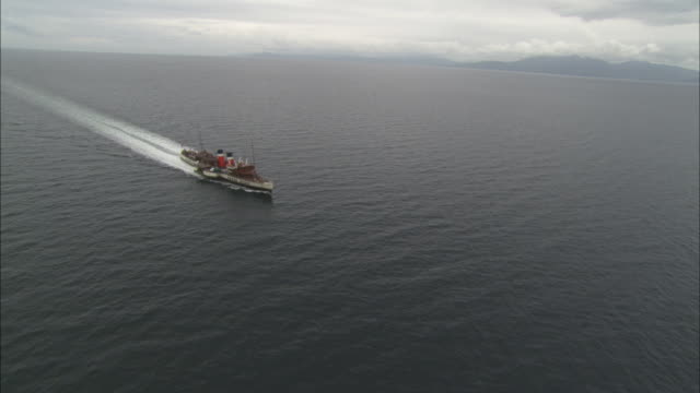 aerial close cumbrae, scotland, north atlantic ocean, ss waverly, oldest sea going steamer in the world, scotland, north atlantic ocean  - north atlantic ocean stock videos & royalty-free footage