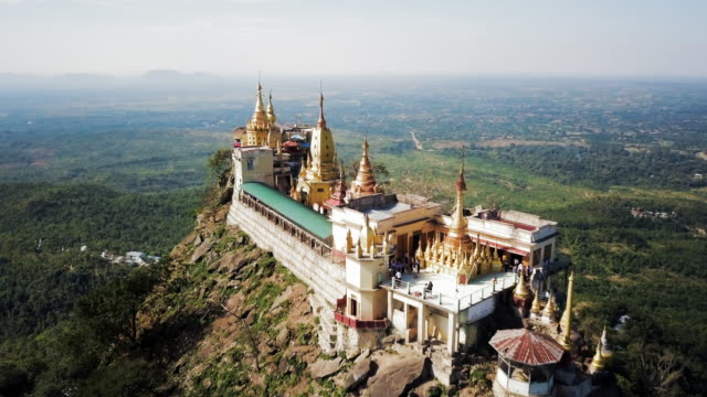 Aerial: Close Look Over the Top of Popa Taungkalat Temple