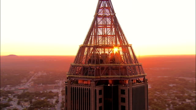 Aerial close up circling tower on Bank of America Plaza at sunrise/ zoom out tower and citycape/ Atlanta, Georgia