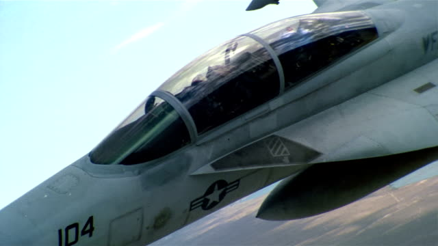 Aerial close up cockpit of two-seat F/A-18 Super Hornet in flight / California