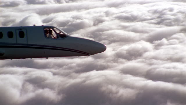 aerial close up jet flying over clouds - private jet stock videos & royalty-free footage