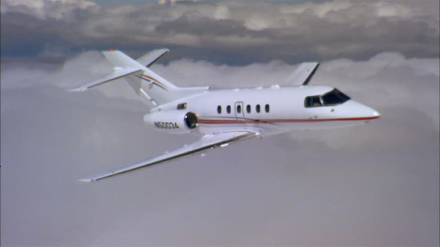 aerial close up private jet flying through clouds - private jet stock videos & royalty-free footage