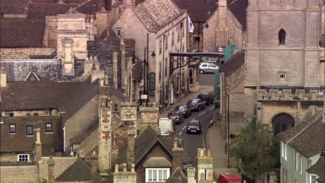 aerial close up the george coaching inn on great north road in stamford / zoom out wide shot surrounding buildings - inn stock videos & royalty-free footage