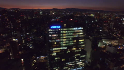 aerial close up to the samsung building in the night - headquarters stock videos & royalty-free footage