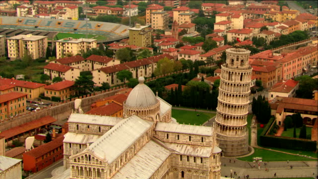 aerial close up tourists on top of leaning tower of pisa / pull out to cathedral / pisa, italy - pisa cathedral stock videos & royalty-free footage