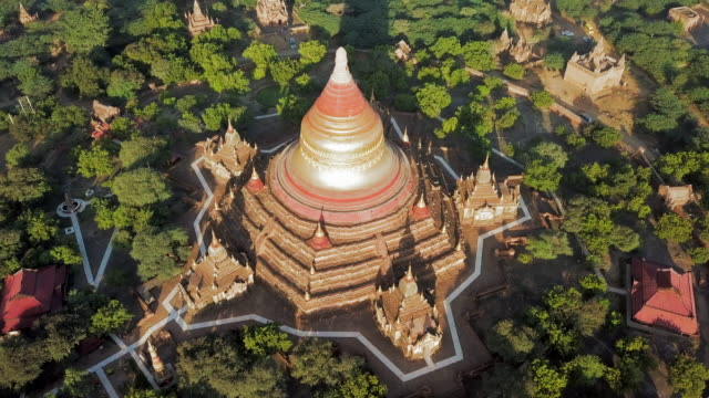 aerial: closer view of a temple in old bagan - bagan stock videos & royalty-free footage