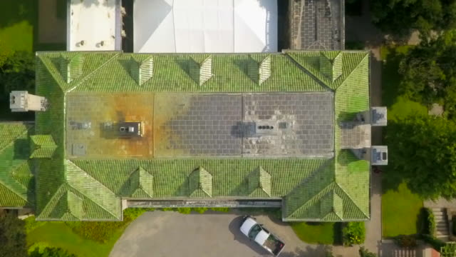 Aerial Close-up: Roof of Mansion Among Lush Green Harkness Memorial State Park