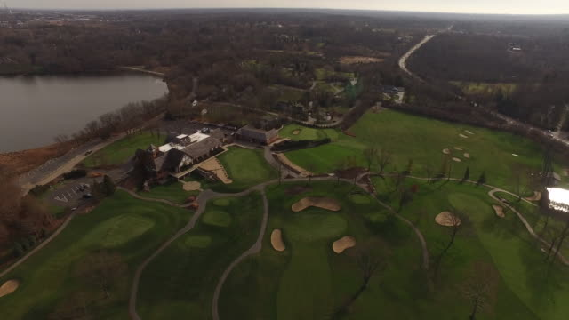 Aerial closing in on golf course club house