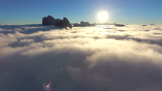 aerial cloudscape at sunrise - white cloud sky stock videos & royalty-free footage