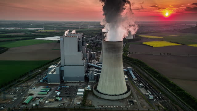 aerial: coal fired power station - coal fired power station stock videos & royalty-free footage