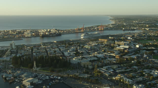 aerial coastal view fremantle harbor at sunset perth - フリーマントル点の映像素材/bロール