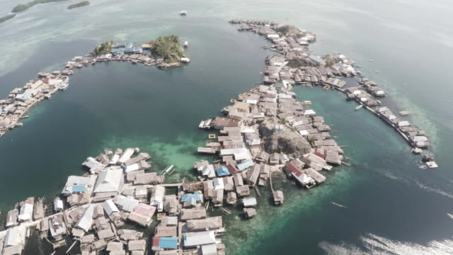 Aerial, coastal village in Indonesia