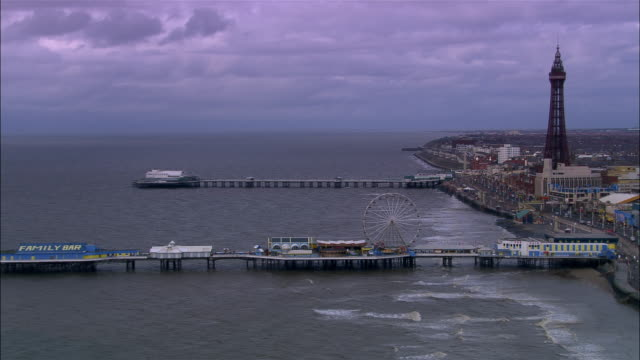 aerial coastline and piers/ blackpool, england - blackpool stock-videos und b-roll-filmmaterial