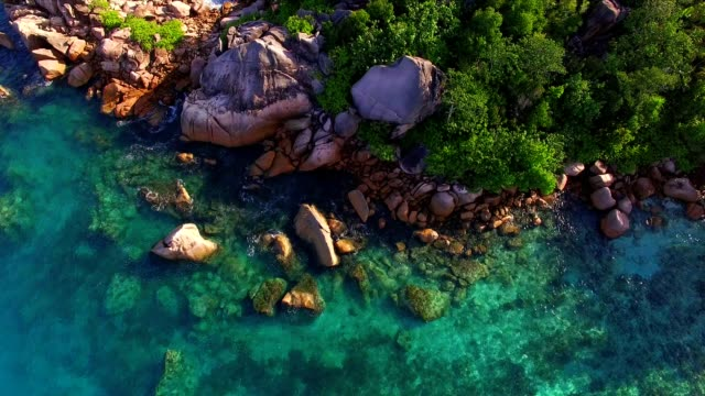 aerial: coastline of praslin island, seychelles - igneous stock videos & royalty-free footage