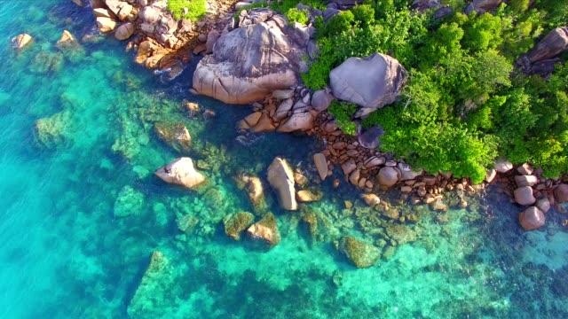 aerial: coastline of praslin island, seychelles - seychelles stock videos & royalty-free footage