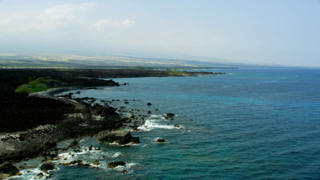 aerial coastline view lava spills big island hawaii - mauna loa stock videos and b-roll footage
