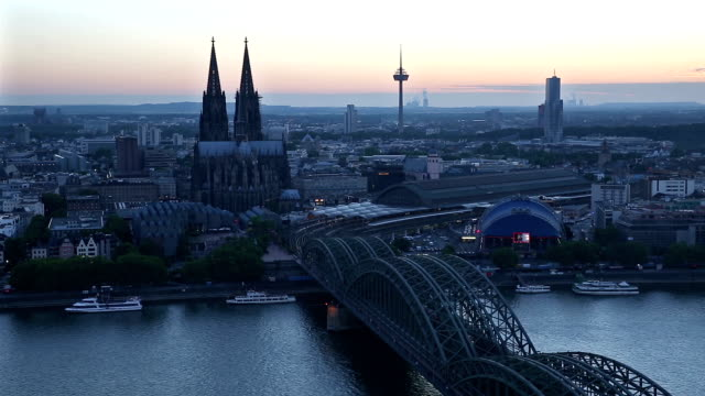 Aerial Cologne Cathedral Hohenzollern Bridge at dusk Germany