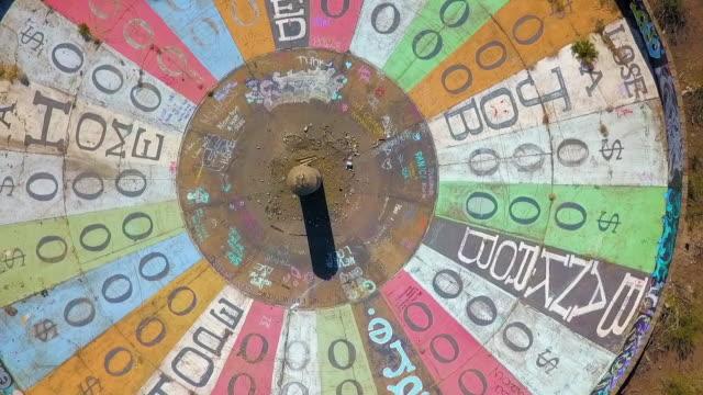 stockvideo's en b-roll-footage met aerial: colorful wheel of misfortune - rijk staat