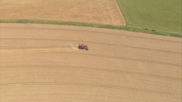 aerial combine harvester - tractor stock videos & royalty-free footage