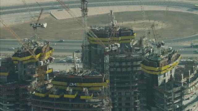 aerial construction cranes high dubai development uae - crane stock videos & royalty-free footage