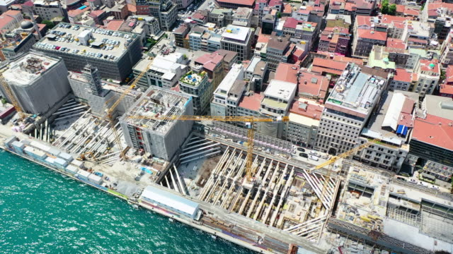 aerial: construction site by beautiful bosphorus strait - istanbul, turkey - built structure stock videos & royalty-free footage