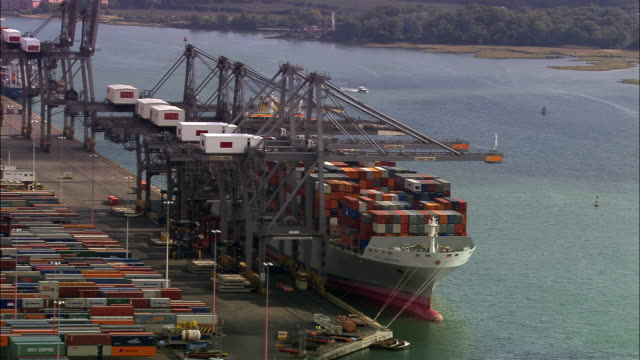 aerial container ship beling loaded at port/ southampton, england - southampton hampshire stock-videos und b-roll-filmmaterial