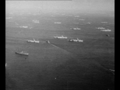 Aerial convoy of military ships off the coast of the Philippines during World War II / montage Supreme Commander Douglas MacArthur looks out to sea...