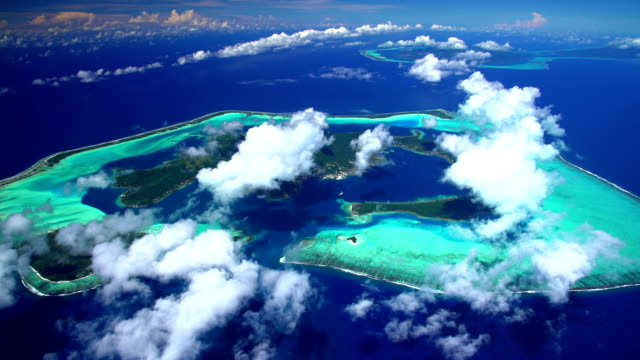 aerial coral reef bora bora and tahaa island - isola di tahaa video stock e b–roll