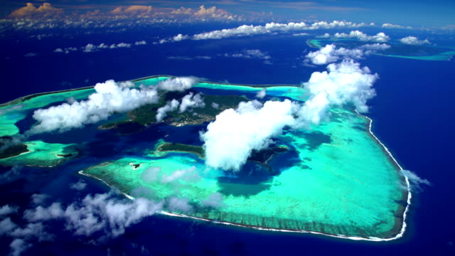 aerial coral reef bora bora and tahaa island - bora bora aerial stock videos and b-roll footage