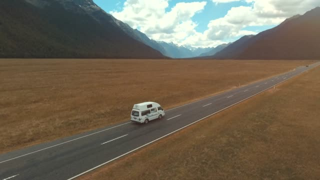 aerial country road driving - new zealand stock videos & royalty-free footage