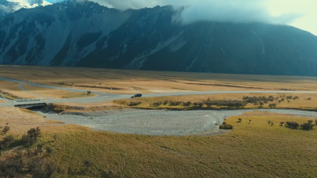 aerial : country road in new zealand - country road stock videos & royalty-free footage