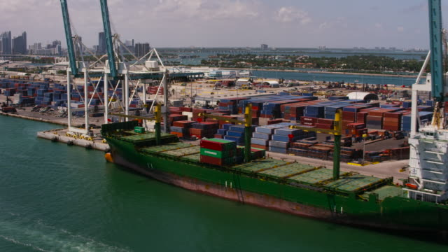 Aerial cranes and cargo ships docked in Miami Florida