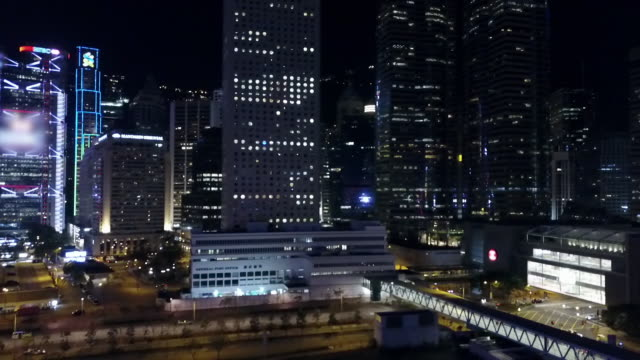 aerial: crowded hong kong skyscrapers lit up at night - central plaza hong kong stock videos & royalty-free footage