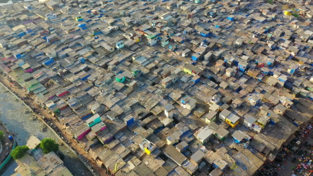 aerial: crowded shanties in slum - mumbai, india - slum stock videos & royalty-free footage