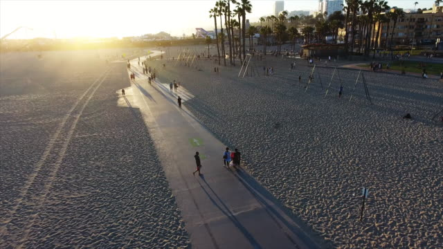 aerial, cyclists biking down path - santa monica stock videos and b-roll footage