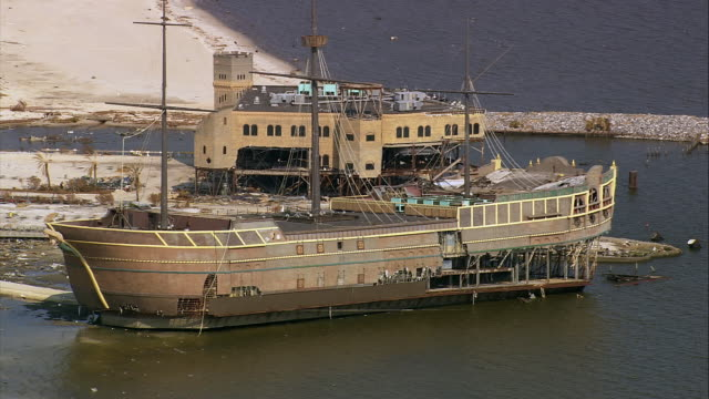 aerial damaged pirate ship with partially destroyed treasure bay casino in background / biloxi, mississippi - b roll stock videos & royalty-free footage