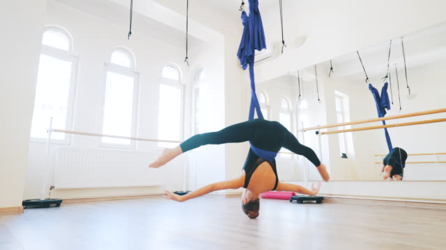 aerial dancer exercising indoor. - ballet studio stock videos and b-roll footage