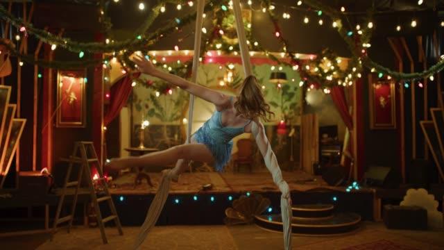 aerial dancer performing on hanging silks in nightclub / provo, utah, united states - circus stock videos & royalty-free footage