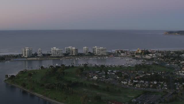 aerial dawn illuminated view glorietta bay san diego - bay of water stock videos & royalty-free footage