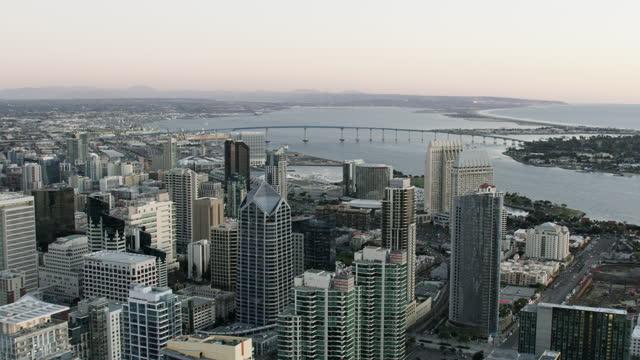 aerial dawn view san diego skyscrapers coronado bridge - san diego stock videos & royalty-free footage