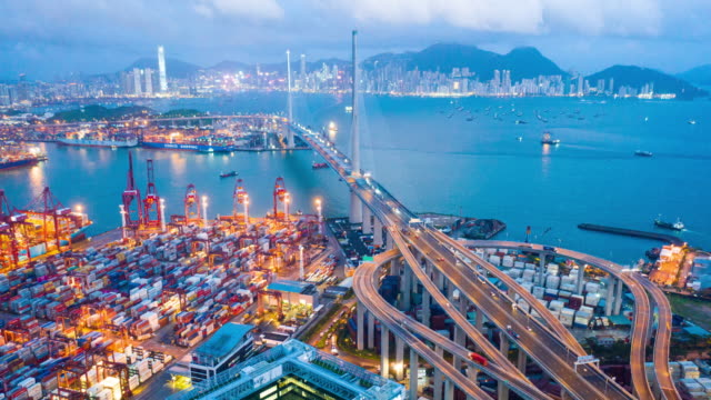 aerial day to night time lapse or hyper lapse of kwai tsing container terminals at dusk - town stock videos & royalty-free footage