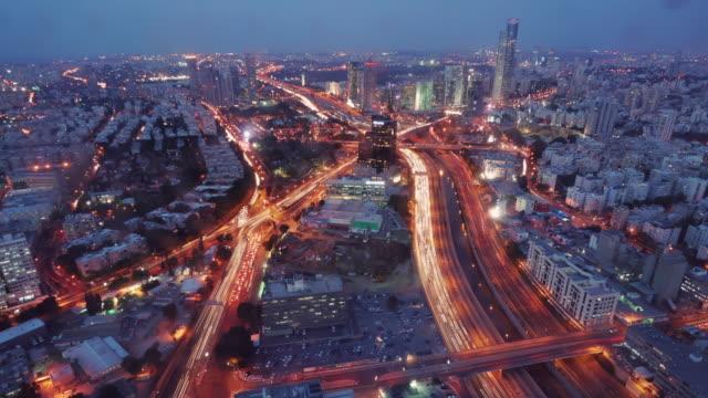 aerial day to night time lapse shot of urban tel aviv - tel aviv stock-videos und b-roll-filmmaterial