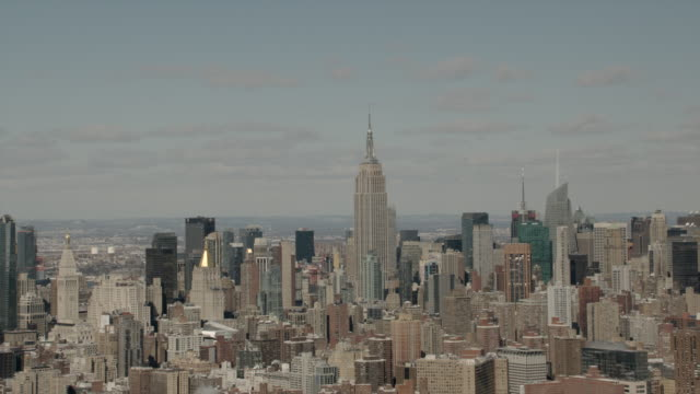 Aerial Daytime Zoom In/ Out of Empire State Building and Midtown Manhattan