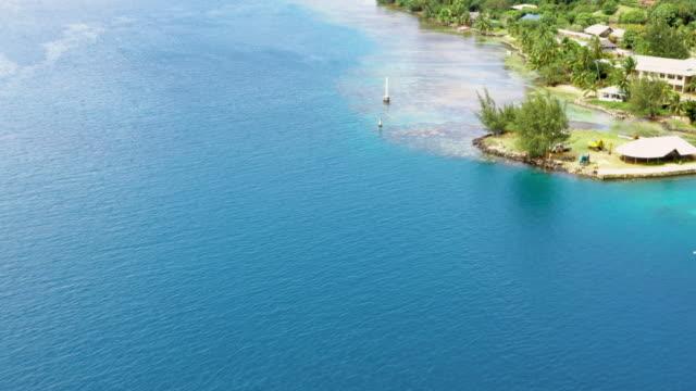 vidéos et rushes de aerial: deep blue calm ocean around moorea island, moorea, french polynesia - moorea