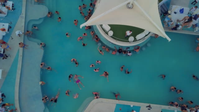 aerial descending: chilling by the pool of resort - cabo san lucas stock videos & royalty-free footage