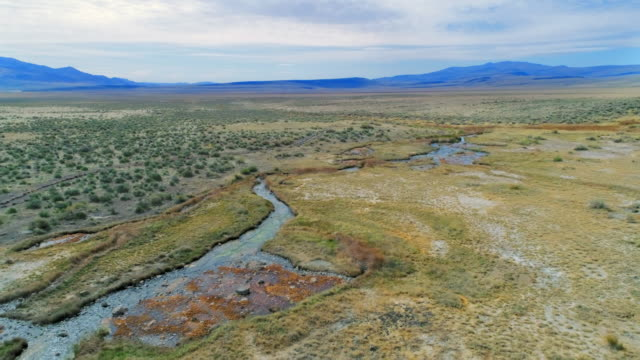 aerial descending: magnificent view of hot spring - meadow stock videos & royalty-free footage