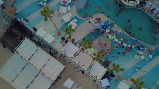 Aerial Descending: Partying at the Club by Pool