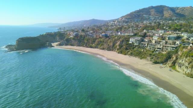 aerial descending: rock formation at laguna beach - laguna beach california stock videos & royalty-free footage