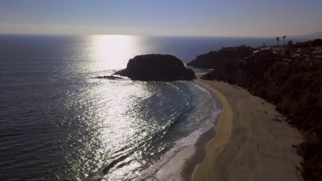 aerial descending: sunset at the laguna beach - laguna beach california stock videos & royalty-free footage