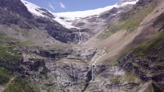 aerial descending: the bernina pass with waterfalls in the middle of mountain - mountain pass stock videos & royalty-free footage